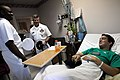 US Navy 090610-N-9818V-330 A patient receives a Navy ball cap from Master Chief Petty Officer of the Navy (MCPON) Rick West and Senior Chief Petty Officer Cedric Levert.jpg