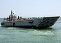 US Navy 090615-N-6676S-456 Landing Craft Mechanized (LCM) 14, assigned to Assault Craft Unit (ACU) 2, transports Sailors, Soldiers and Marines during operations supporting Joint Logistics Over-The-Shore (JLOTS) exercises.jpg