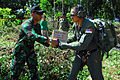 US Navy 091009-N-9123L-108 Indonesian Air Force 1st Lt. Prasetyo Aguswouo and Air Force Capt. Tony Truong, from Los Angeles, Calif., unload relief supplies from a CH-53E Super Stallion helicopter assigned to the Dragons of Mari.jpg