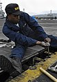 US Navy 091020-N-4954I-035 Aviation Boatswain's Mate (Equipment) Airman Recruit Ryann McKinney, from Portsmouth, Va., tightens a bolt.jpg