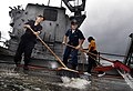 US Navy 091113-N-0807W-327 Sailors aboard USS Harpers Ferry (LSD 49) scrub the weather decks during an aqueous film forming foam countermeasure wash down.jpg