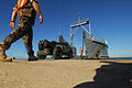 US Navy 100129-N-7918H-087 U.S. Navy Seabees assigned to Navy Cargo Battalion (NCHB) 1 and U.S. Army Soldiers assigned to the 97th Transportation Company load pallets of water.jpg