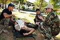 US Navy 100204-N-1008D-190 A special warfare operator (SEAL) medic critiques students from the Armed Forces of the Philippines Naval Special Operations Group who are administering first-aid.jpg