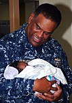 US Navy 100217-N-8366W-062 Rear Adm. Victor Guillory, commander of the U.S. 4th Fleet, holds a Haitian child aboard the Military Sealift Command hospital ship USNS Comfort (T-AH 20).jpg