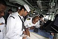 US Navy 100313-N-8335D-010 Lt. Cmdr. Patrick German, right, and Quartermaster 2nd Class David Mora plot the ship's position.jpg