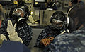 US Navy 100830-N-7280V-341 Mass Communication Specialist 2nd Class Steven Khor, left, and Mass Communication Specialist 3rd Class Fidel Hart don MCU-2P gas masks during a chemical, biological and radiological attack drill.jpg