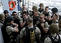 US Navy 110325-N-BZ392-066 Sailors assigned to the VBSS team aboard USS Leyte Gulf (CG 55) prepare for an operation on the Philippine-flagged merc.jpg
