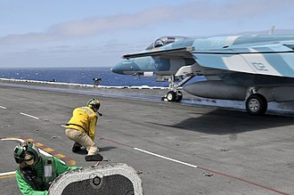 VFA-122 - Image: US Navy 110803 N MK401 079 A shooter signals the launch of an F A 18E Super Hornet aboard USS Abraham Lincoln (CVN 72)