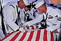 US Navy 110911-N-SM578-037 Chief petty officer selects retire an American flag during a ceremony commemorating the ten-year anniversary of the Sept.jpg