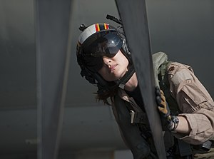 US Navy 120125-N-DR144-220 Plane Commander Lt. Cmdr. Tara Refo, assigned to Carrier Airborne Early Warning Squadron (VAW) 125, inspects the aircraf.jpg
