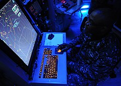 US Navy 120208-N-TU894-017 Air-Traffic Controller 1st Class Justin S. Brown tracks incoming aircraft from the carrier air traffic control center ab.jpg