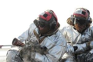 US Navy 120210-N-ZZ999-270 Sailors simulate combating an aircraft fire during flight deck firefighting drills.jpg