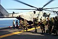 US Navy 990608-N-8230O-003 U.S. Marines board CH-53.jpg