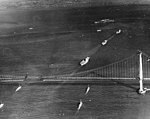 US Navy aircraft carriers passing under the Golden Gate Bridge in November 1936.jpg