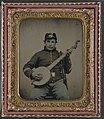 Unidentified soldier in Union cavalry uniform with banjo, sword, and pipe LOC 9158103335.jpg