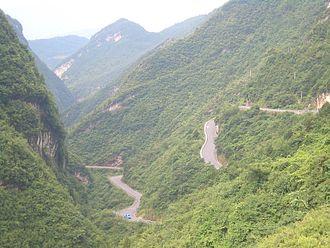 China National Highway 209 - Highway 209 climbing from the Liangtai River valley (Gaoqiao town) toward Wanchaoshan Mt (Wujiaping), in Xingshan County, Hubei