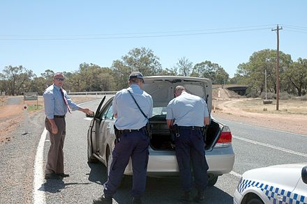 New South Wales Police Force officers search the vehicle of a suspected drug smuggler at a border crossing. Wentworth, New South Wales, Australia Vehicle drug search australia.jpg