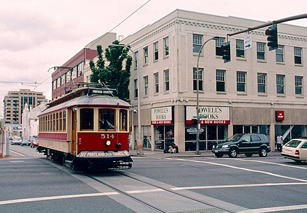 A Vintage Trolley in service on the Portland Streetcar line in 2001, passing Powell's Books. Operation of these cars on the PS line ended in 2005. Vintage Trolley passing Powell's Books, 7-29-2001.jpg