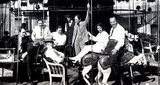 Leo Birinski - One of the few known images of Birinski. Breake during the shooting of the motion picture Das Wachsfigurenkabinett; Leo Birinski is on the right, sitting on the white horse (c. 1923).