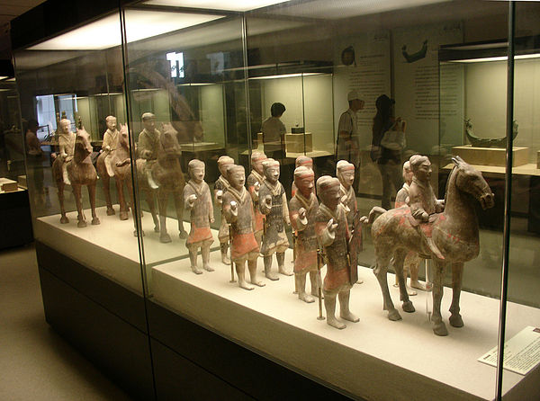 Western-Han miniature pottery infantry (foreground) and cavalry (background); in 1990, when the tomb complex of Emperor Jing of Han (r. 157 - 141 BC) and his wife Empress Wang Zhi (d. 126 BC) was excavated north of Yangling, over 40,000 miniature pottery figures were unearthed. All of them were one-third life size, smaller than the 8,000-some fully life size soldiers of the Terracotta Army buried alongside the First Emperor of Qin. Smaller miniature figurines, on average 60 centimeters (24 in) in height, have also been found in various royal Han tombs where they were placed to guard the deceased tomb occupants in their afterlife. Western Han soldiers 4.jpg