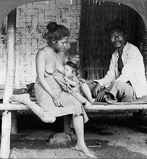 Breastfeeding in public - Indonesian woman breastfeeding in public.