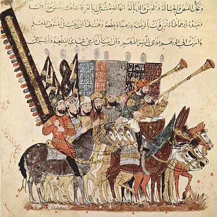 A troop of spectators on horseback and with inscribed banners watching a procession. Illustration from the seventh Maqama of al-Hariri of Basra in a 13th-century manuscript (BNF ms. are 5847).