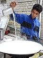 Young Man Pouring Milk - Manali - Himachal Pradesh - India (26568115366).jpg