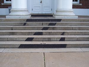 Secret societies at the University of Virginia - The sign of the Z society in black outside the steps to Old Cabel Hall