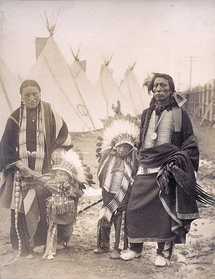 Chief Black Tail Deer and his family at the 1904 World's Fair