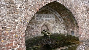 """Hascombe - """"Whosoever will let him take the water of life freely"""". Inscription on the fountain at Hascombe built in 1877 by Edward Lee Rowcliffe in remembrance of his brother Henry."""