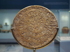 Round clay disc with symbols