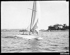 8-metre class yacht, possibly NORN, on Sydney Harbour (11805824465).jpg