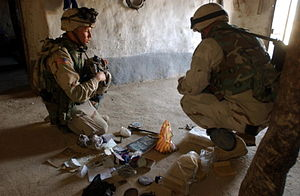 Document Exploitation - Paratroopers of the 82d Airborne Division secure documents after a raid in Afghanistan