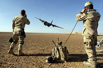 United States Air Force Combat Control Team - Air Force Combat Controllers participating in Operation Enduring Freedom provide air traffic control to a C-130 taking off from a remote airfield.