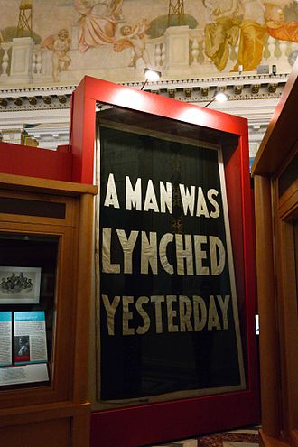 "Civil rights movement (1896–1954) - ""A Man Was Lynched Yesterday"" flag, hanging at the Library of Congress"