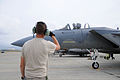 A U.S. Air Force crew chief signals Lt. Col. James Bong, commanding officer of 120th Fighter Wing, Detachment 1, Montana Air National Guard, following a training flight in an F-15E Strike Eagle aircraft at Joint 121205-Z-UJ603-210.jpg