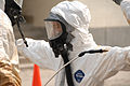 A U.S. military service member undergoes decontamination during a joint training exercise conducted by the U.S. Air Force and the U.S. Army involving biological and chemical warfare response, casualty rescue and 080626-A-BB257-090.jpg
