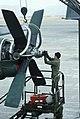 A US Air Force technician servces a C-130 Hercules aircraft engine during Exercise TEAM SPIRIT'86 - DPLA - c90cfb686001fc3ce1422fa5ced98e33.jpeg