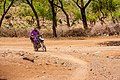 A masai driving a motorcycle in the village.jpg