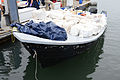 A panga boat that was seized by U.S. Coast Guard crews from San Diego and Sacramento loaded with approximately 7,600 pounds of marijuana is moored at a pier in San Diego June 28, 2014 140628-G-JY570-063.jpg