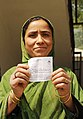 A woman voter displaying her voter slip, at a polling booth, during the 7th Phase of General Elections-2014, in Srinagar, Jammu & Kashmir on April 30, 2014.jpg