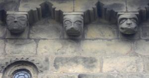 St John the Baptist Church, Adel - The corbel frieze and round Romanesque window