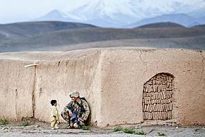 2012 in Afghanistan - Sgt. Joshua Smith, US Army meets an Afghan boy in Ghazni province, April 28, 2012.