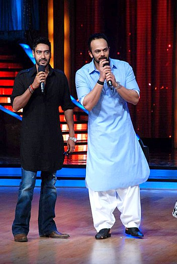 Ajay Devgn, Rohit Shetty on the sets of 'Jhalak Dikhhlaa Jaa 5'. One of the most successful Actor-Director duos. One of the first film for which they collaborated was Golmaal: Fun Unlimited (2006). Ajay Devgn, Rohit Shetty on the sets of 'Jhalak Dikhhlaa Jaa 5'.jpg