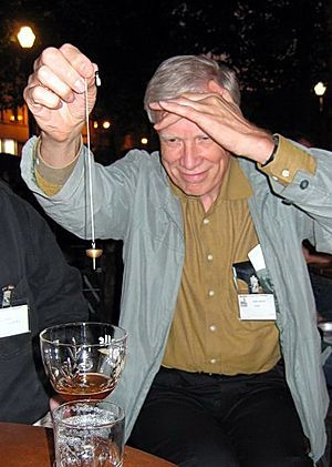 James Alcock - James Alcock dowsing for beer at the 2005 Euroskeptics Conference in Brussels. His lecture was The appeal of alternative medicine.
