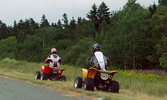 ATVs in New Brunswick, Canada. Note that one of them is plated, an obligation in New Brunswick to legally cross and roll on roads for a maximum of a few hundred meters. All-terrain vehicle Quad. New Brunswick 2008 7575.jpg