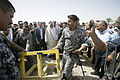 An Iraqi policeman moves the last roadblock during the reopening of a road near Karmah, Iraq, and Forward Operating Base Omar April 14, 2008 080414-M-RF524-005.jpg