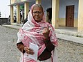 An old woman voter showing mark of indelible ink after casting her vote, at a polling booth, during the 8th Phase of General Elections-2014, in Nainital, Uttarakhand on May 07, 2014.jpg