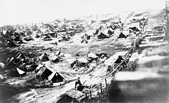 Andersonville National Historic Site - Andersonville prisoners and tents, southwest view showing the dead-line, August 17, 1864