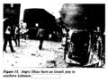Angry Shias burn an Israeli jeep.png